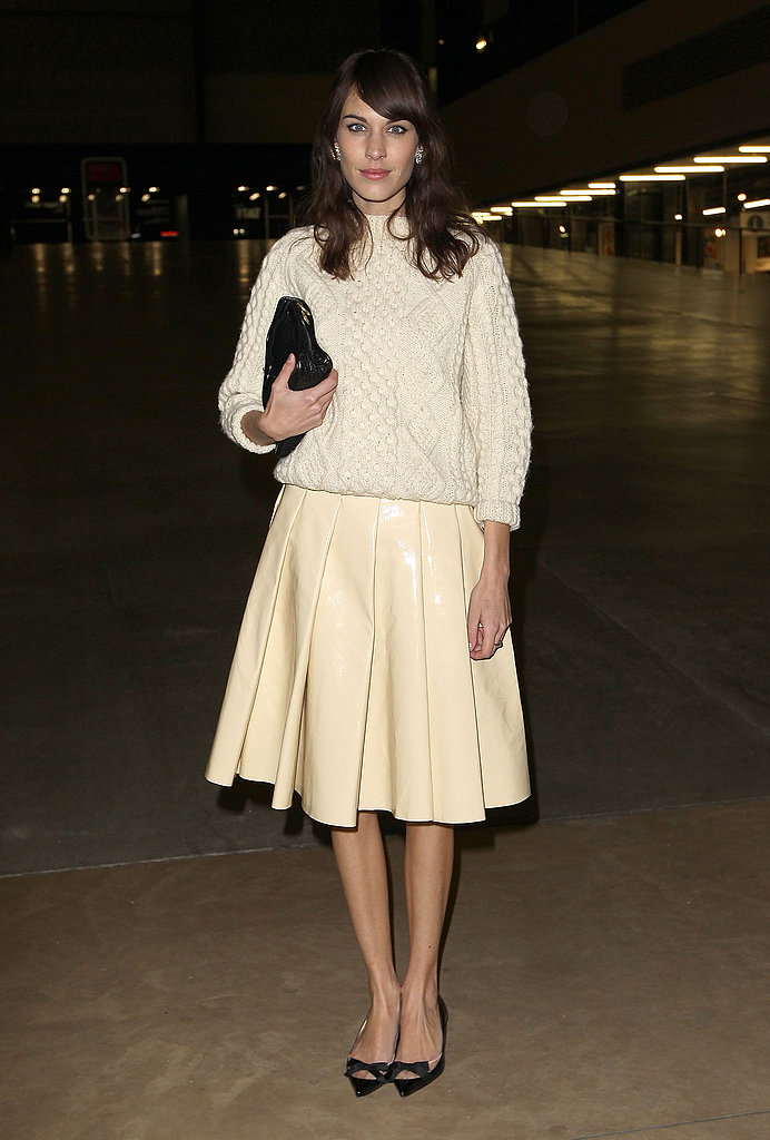 Alexa Chung brought her sweet style to the J.W.Anderson Fall 2013 show in London in a knit sweater and a cream-colored leather skirt.