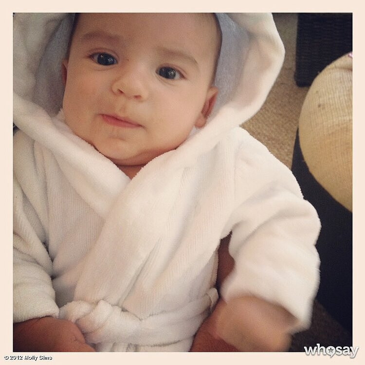 Molly Sims's son, Brooks, was all warm and snuggly after his bath. Source: Twitter user MollyBSims