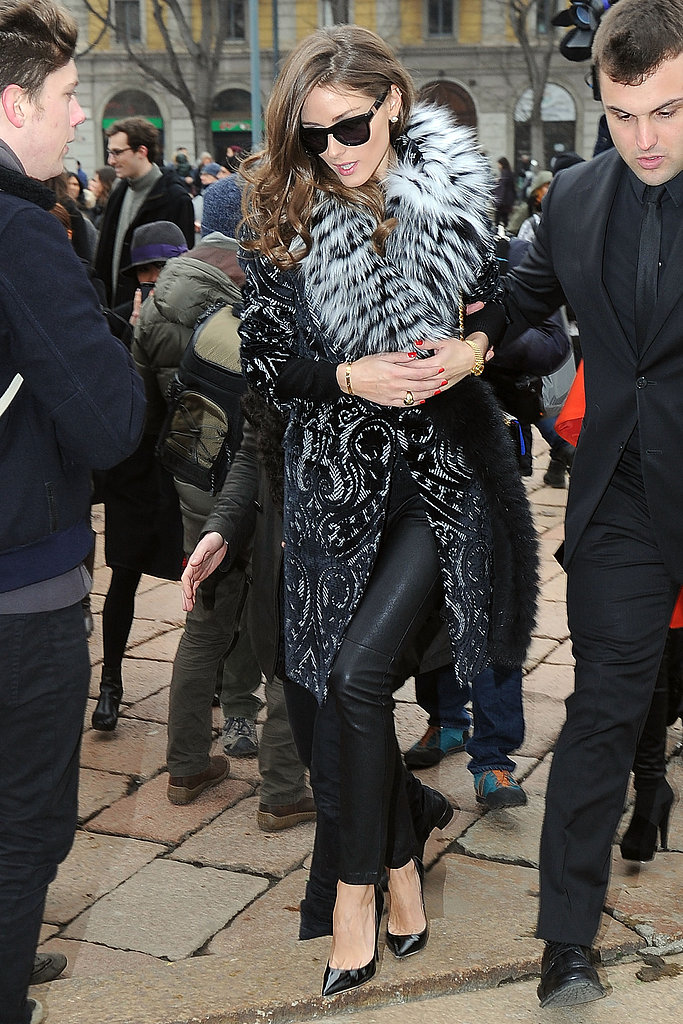 Olivia Palermo made a posh arrival at Roberto Cavalli in a fur collar, topped over a printed coat, black leather pants, and sexy black patent pointy pumps.
