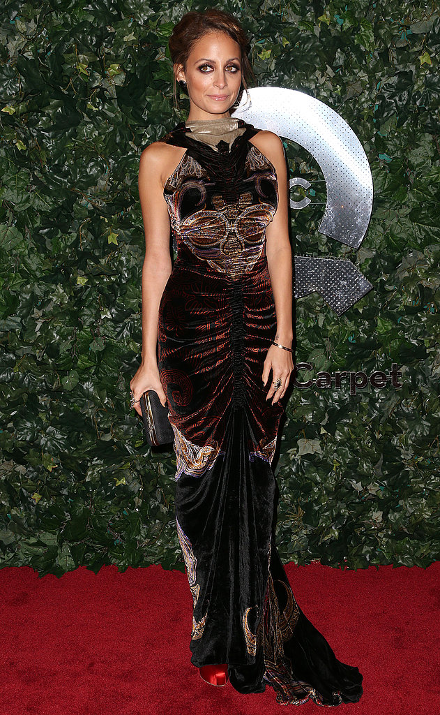 Nicole Richie called on her dark side in a velvet gown and red satin Brian Atwood pumps at the QVC Red Carpet Style event in LA.
