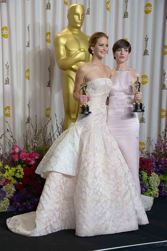 Anne Hathaway posed with Jennifer Lawrence in the Oscars press room.