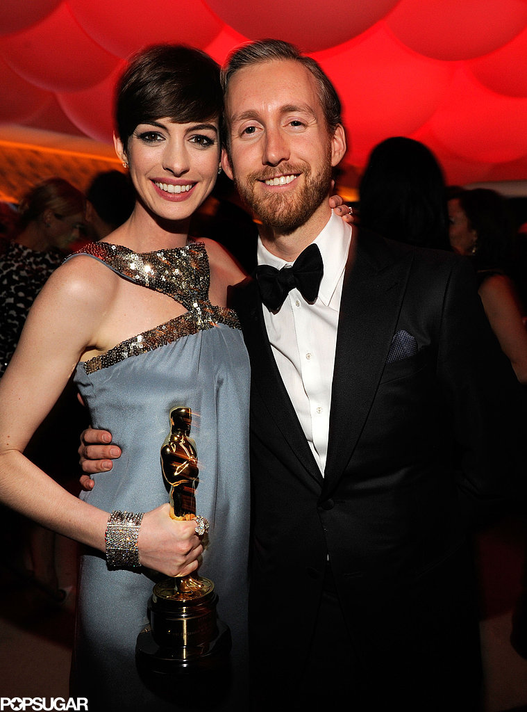 Anne Hathaway brought her husband, Adam Shulman, and her Oscar to the Vanity Fair after-party.