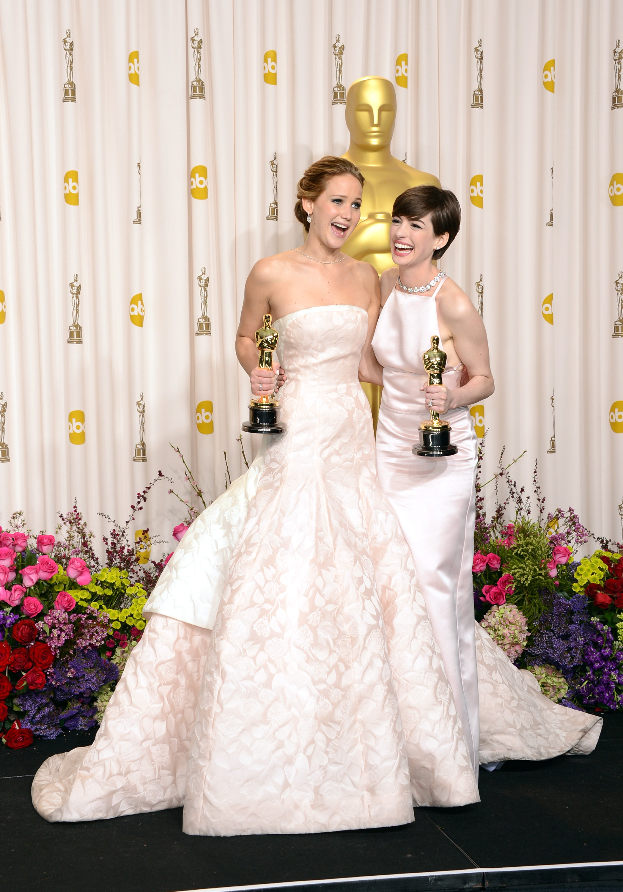 Jennifer Lawrence and Anne Hathaway backstage at the Oscars 2013.