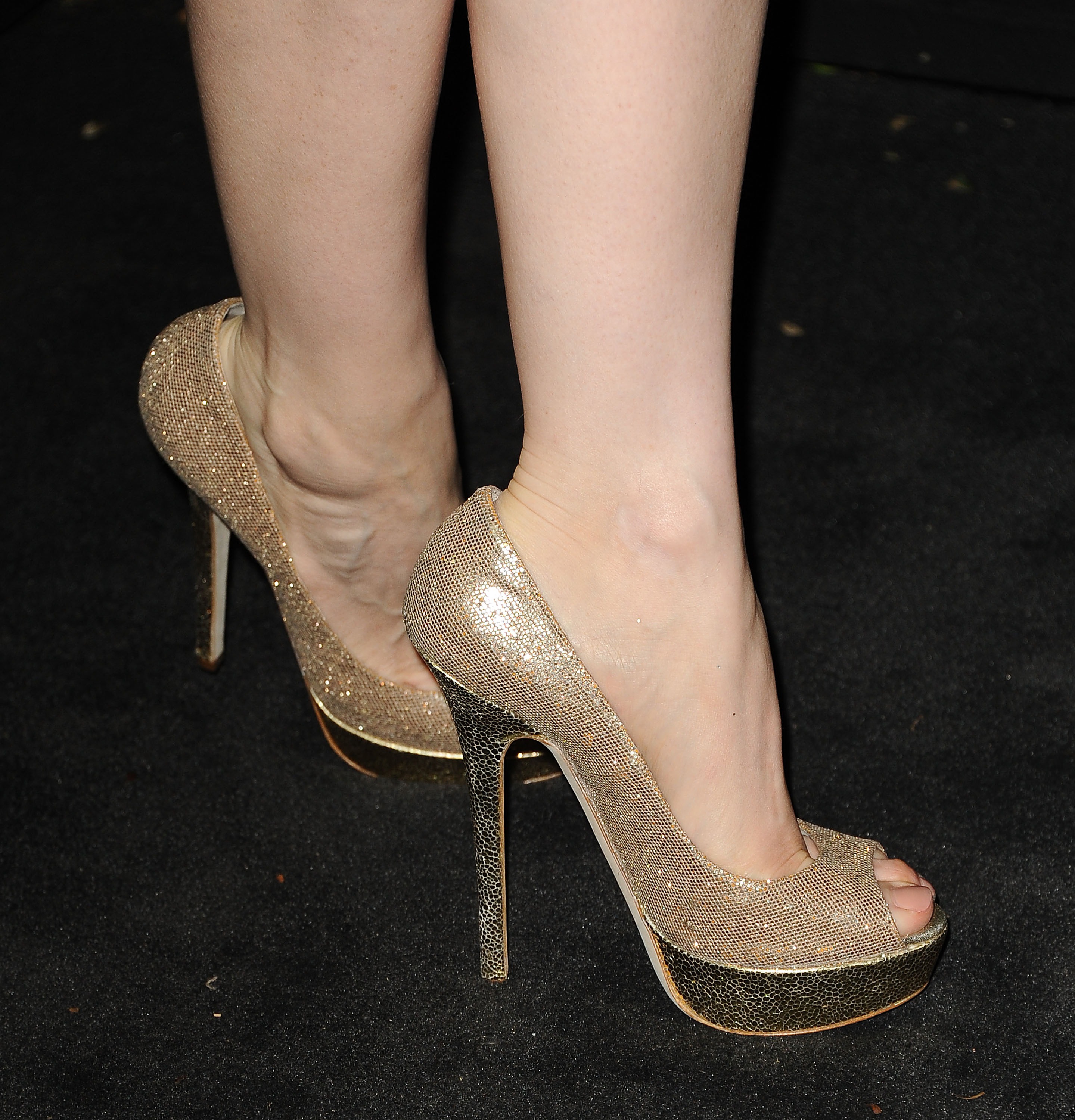 Jessica Chastain's gold glittery Jimmy Choo peep-toes added more pizazz to her white pleated Chanel dress at the Chanel dinner.