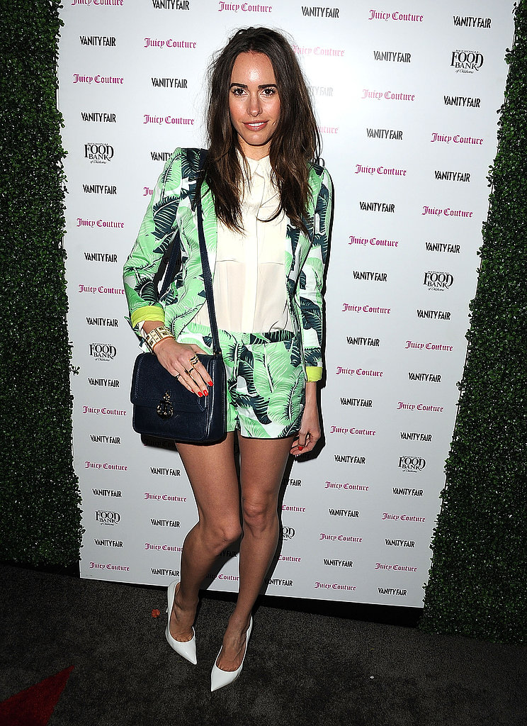 At a Vanity Fair and Juicy Couture party in LA, Louise Roe wore her white pointy pumps with a verdant printed shorts suit, creating the perfect Spring pairing.