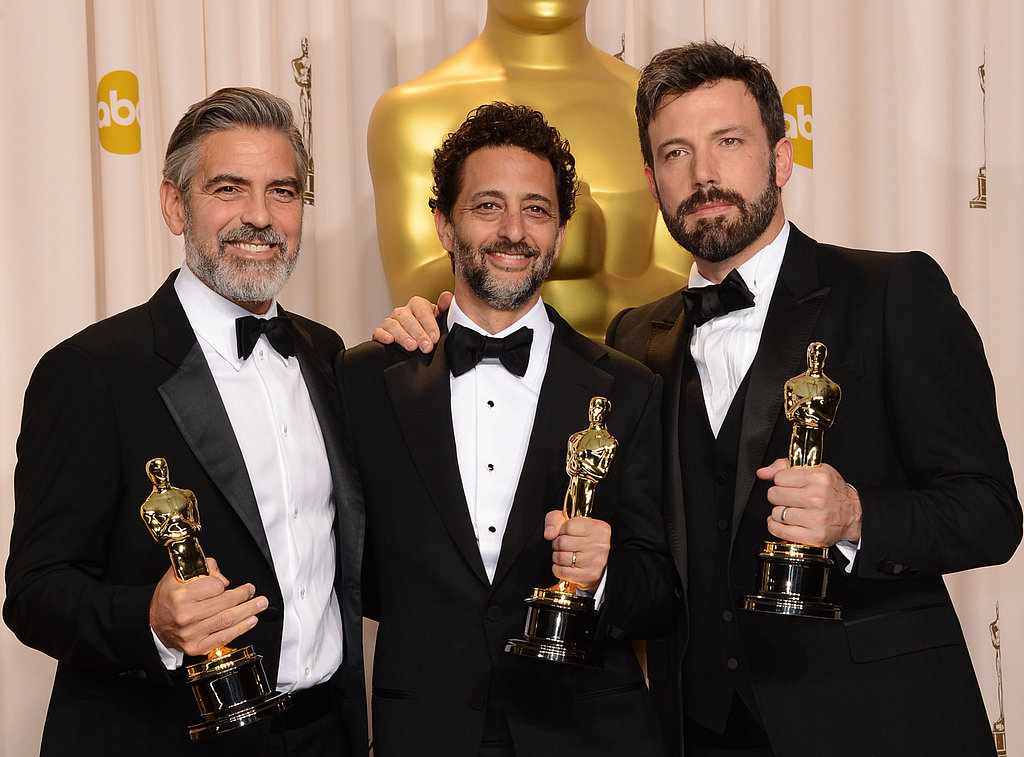 George Clooney, Ben Affleck, and Grant Heslov showed off their Oscars int he press room.