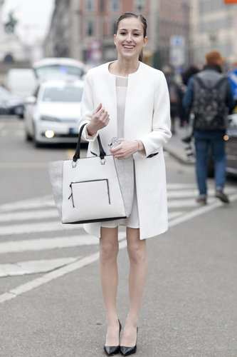 """The chicest of """"Winter"""" gear in all white — and with classic heels."""