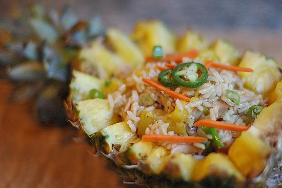 Add fresh pineapple to traditional fried rice for this delicious pineapple fried rice recipe.