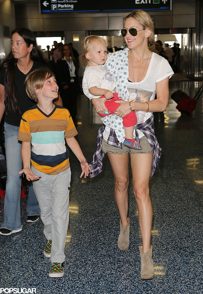 Kate Hudson and her sons Ryder and Bing walked through Miami International airport on Wednesday.