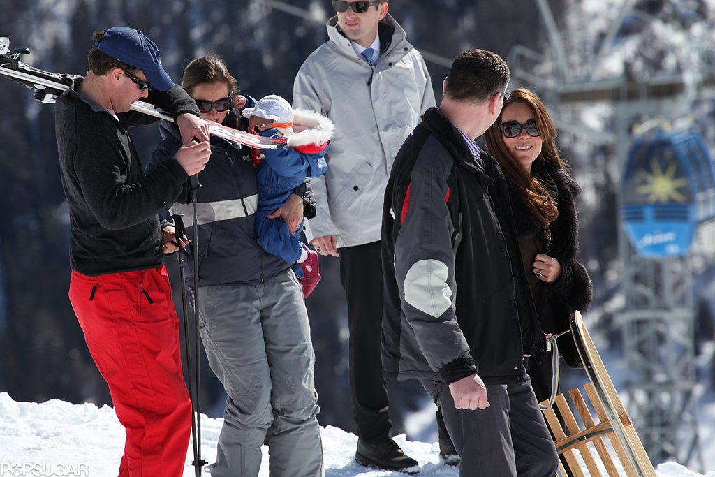 Pregnant Kate Middleton carried a sled in the Swiss Alps.