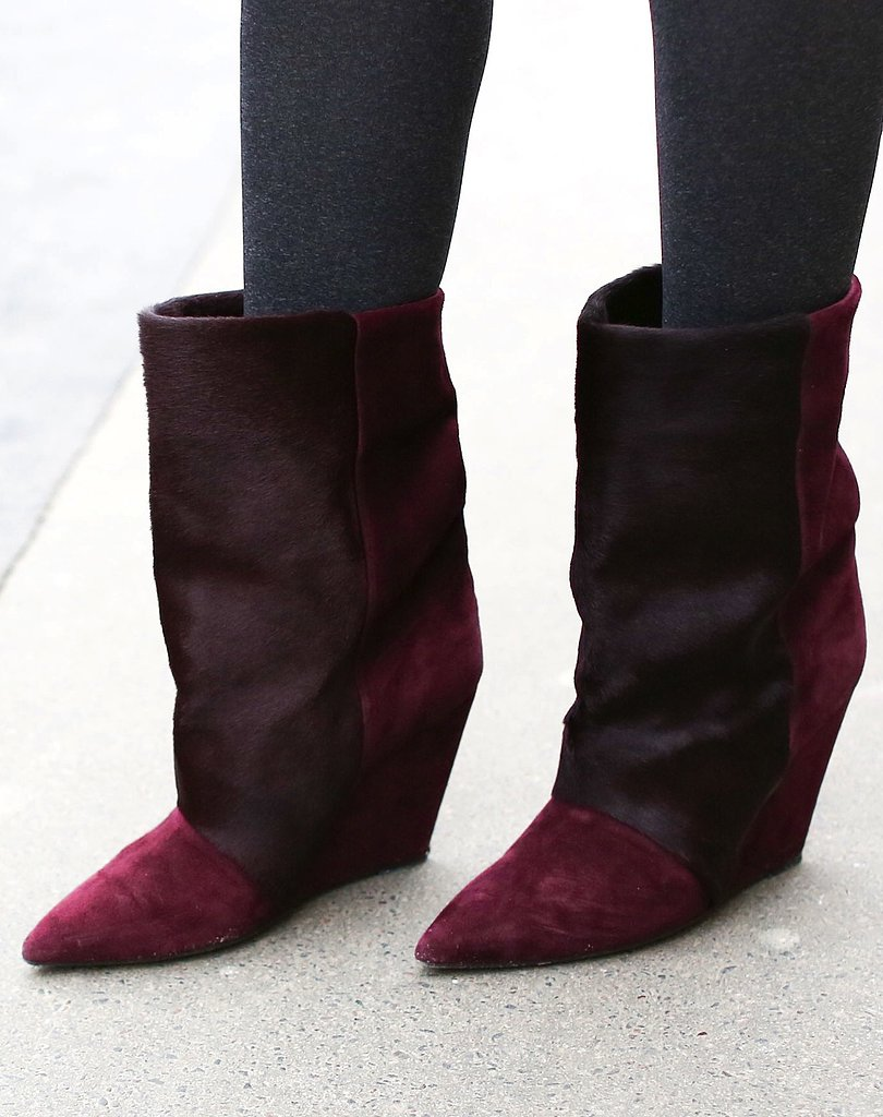Isabel Marant boots made another appearance at Paris Fashion Week, this time featuring a chic oxblood hue and luxe texture.