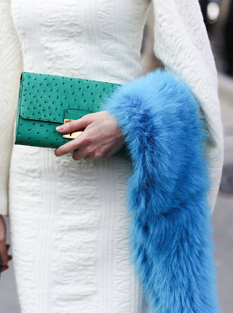 A turquoise clutch and furry blue stole added major contrast against a white dress.