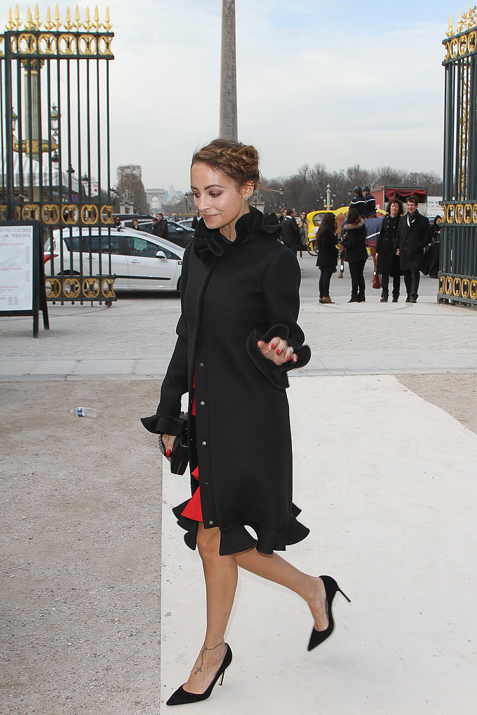 On her way into Valentino's show, Nicole Richie showed off her girlie side in a black ruffled coat from the house.