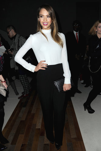 Jessica Alba attended Valentino's Fall 2013 show at Paris Fashion Week looking sophisticated in a black and white pairing, finished with a black studded clutch.