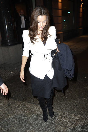 While out on the town in Berlin, Eva Longoria paired a white belted  Stella & Jamie jacket with a black knee-length skirt and black suede boots.