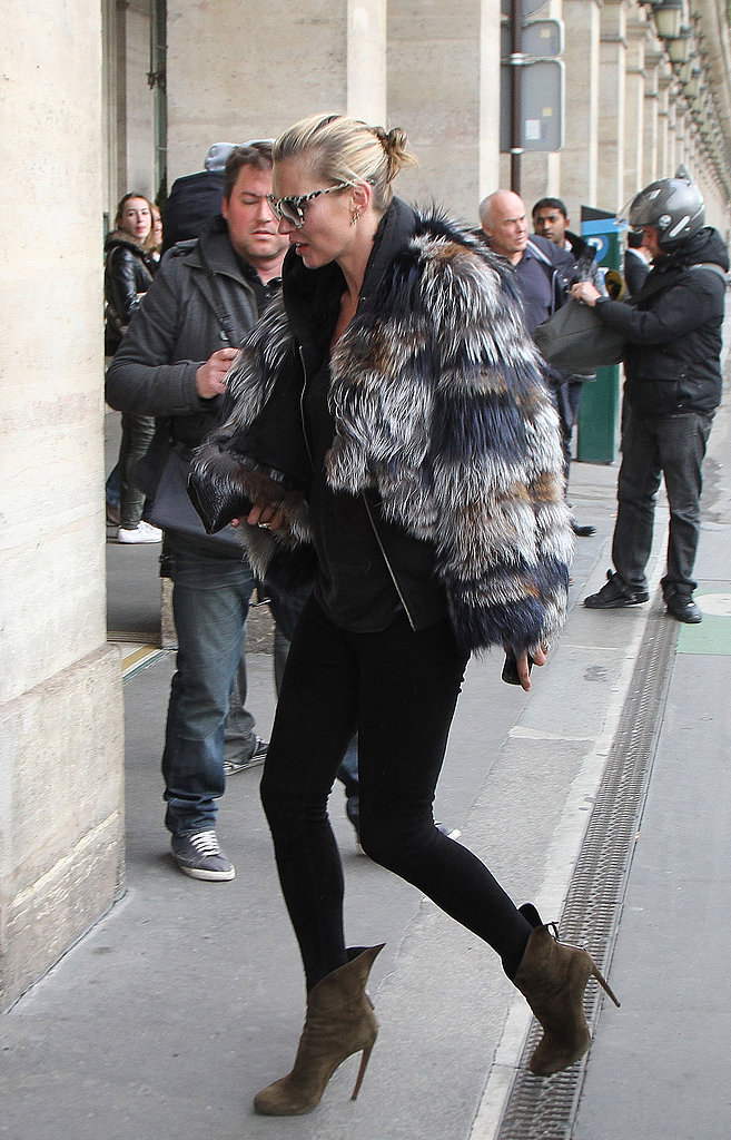 Outside the PFW premises, Kate Moss showed off her signature style in a fur coat, skinny black jeans, and olive booties.