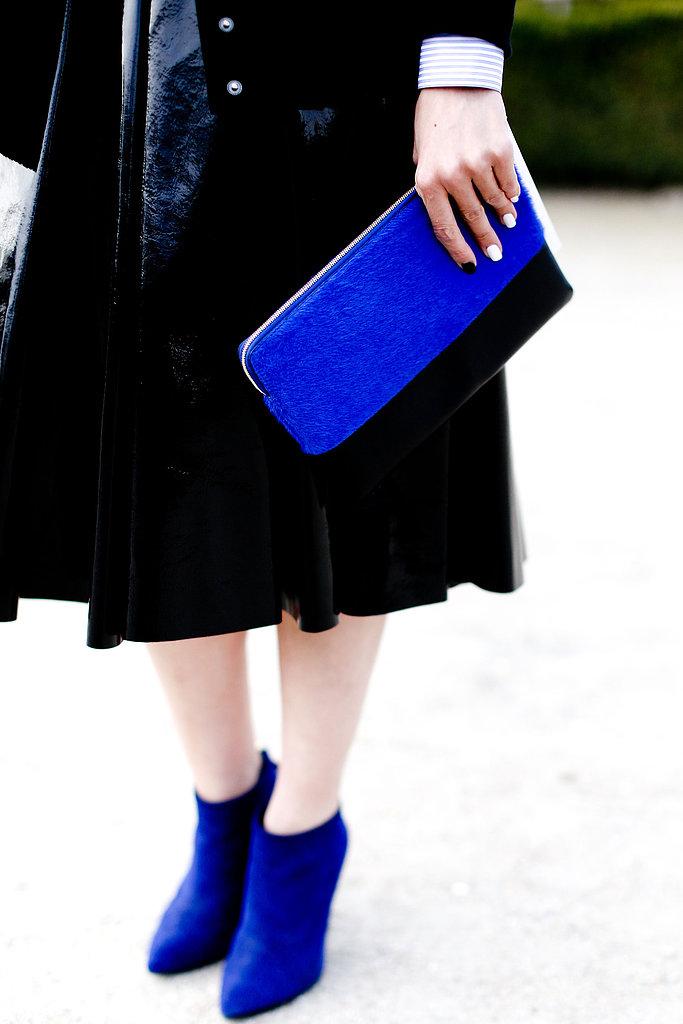 A black ensemble got a jolt of excitement via bright blue accessories.