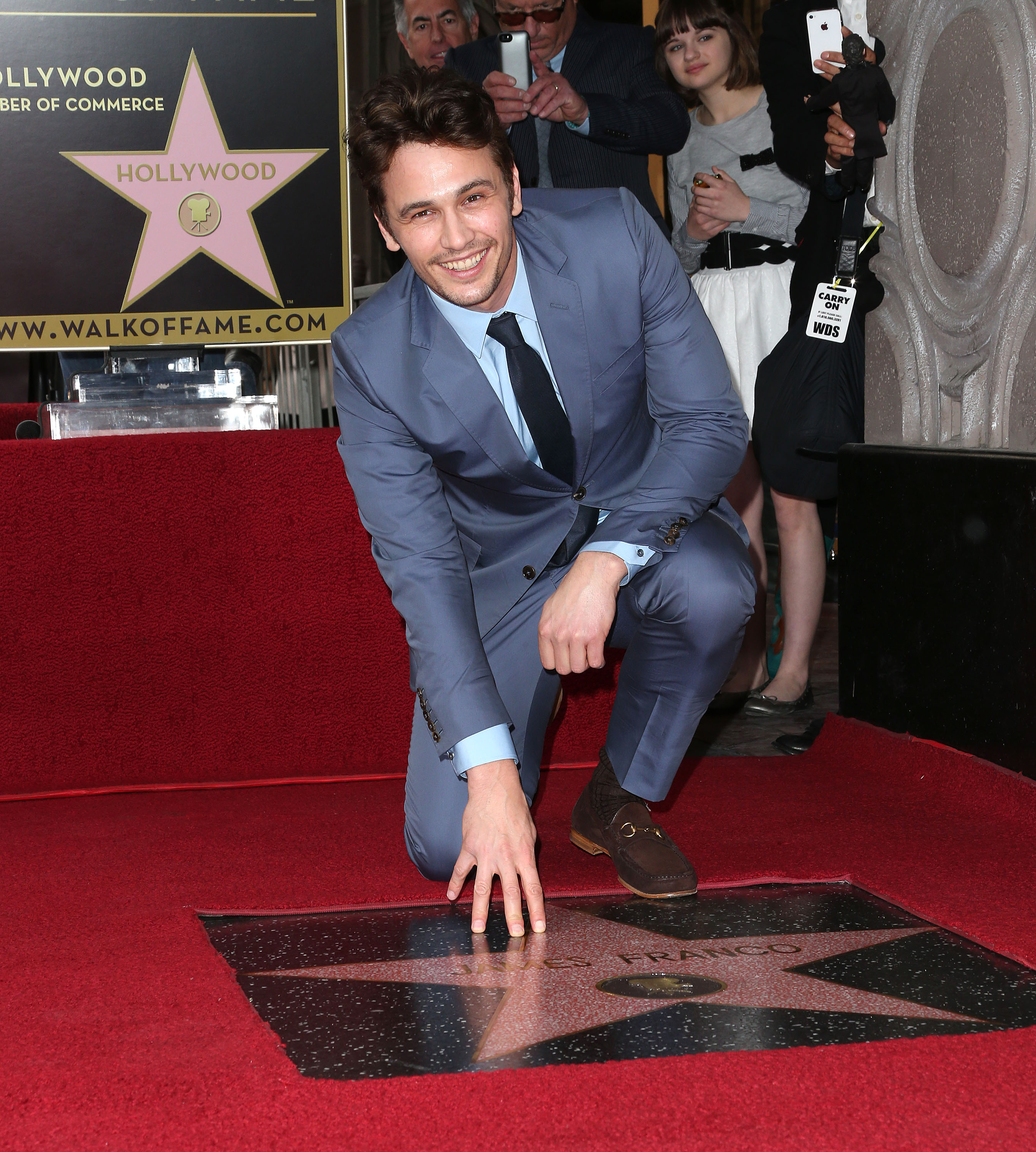 James Franco posed by his Walk of Fame star.
