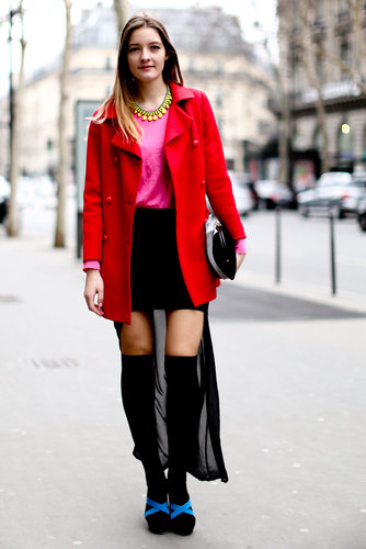 Pops of bold color played opposites against her black skirt and tights.