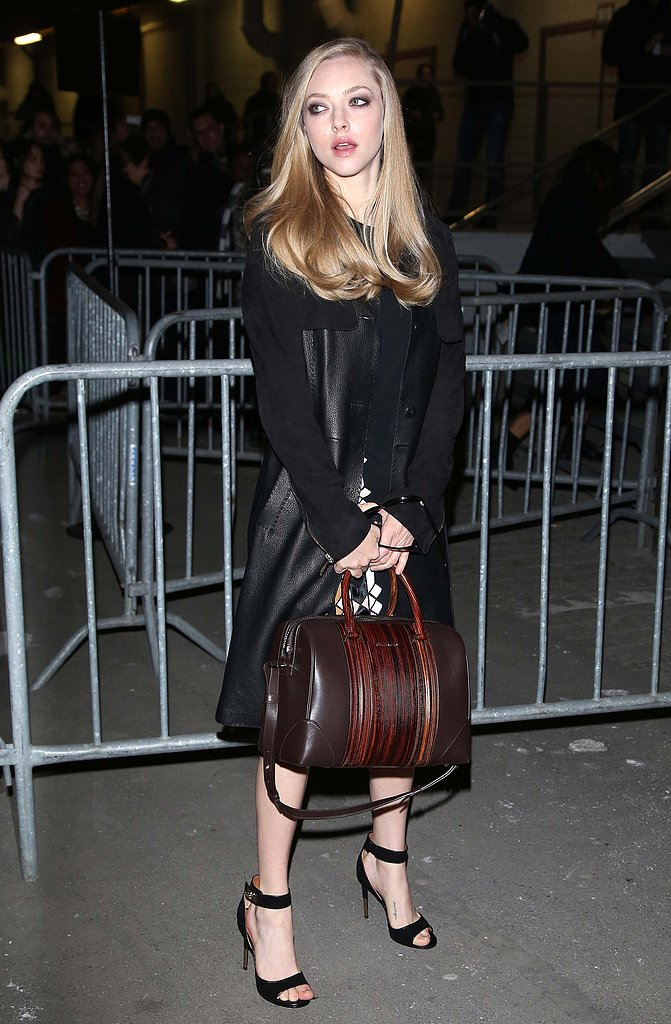 Outside Givenchy's Fall 2013 show during Paris Fashion Week, Amanda Seyfried showed off her other Givenchy Lucrezia tote in brown.