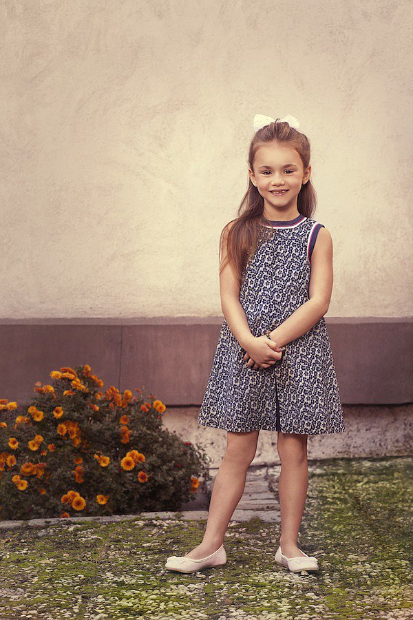 "The Navy Floral Print Dress ($138) was made with ""Scarlet,"" a 5-year-old Texan, in mind. The precocious tot romps with her older brothers, and dreams of being an actress when she grows up!"