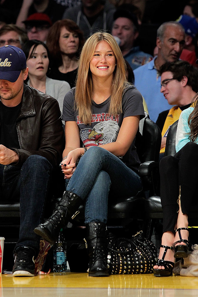 Bar Refaeli kept things rocker-cool in a vintage tee and motorcycle boots for a Lakers game in January 2010.