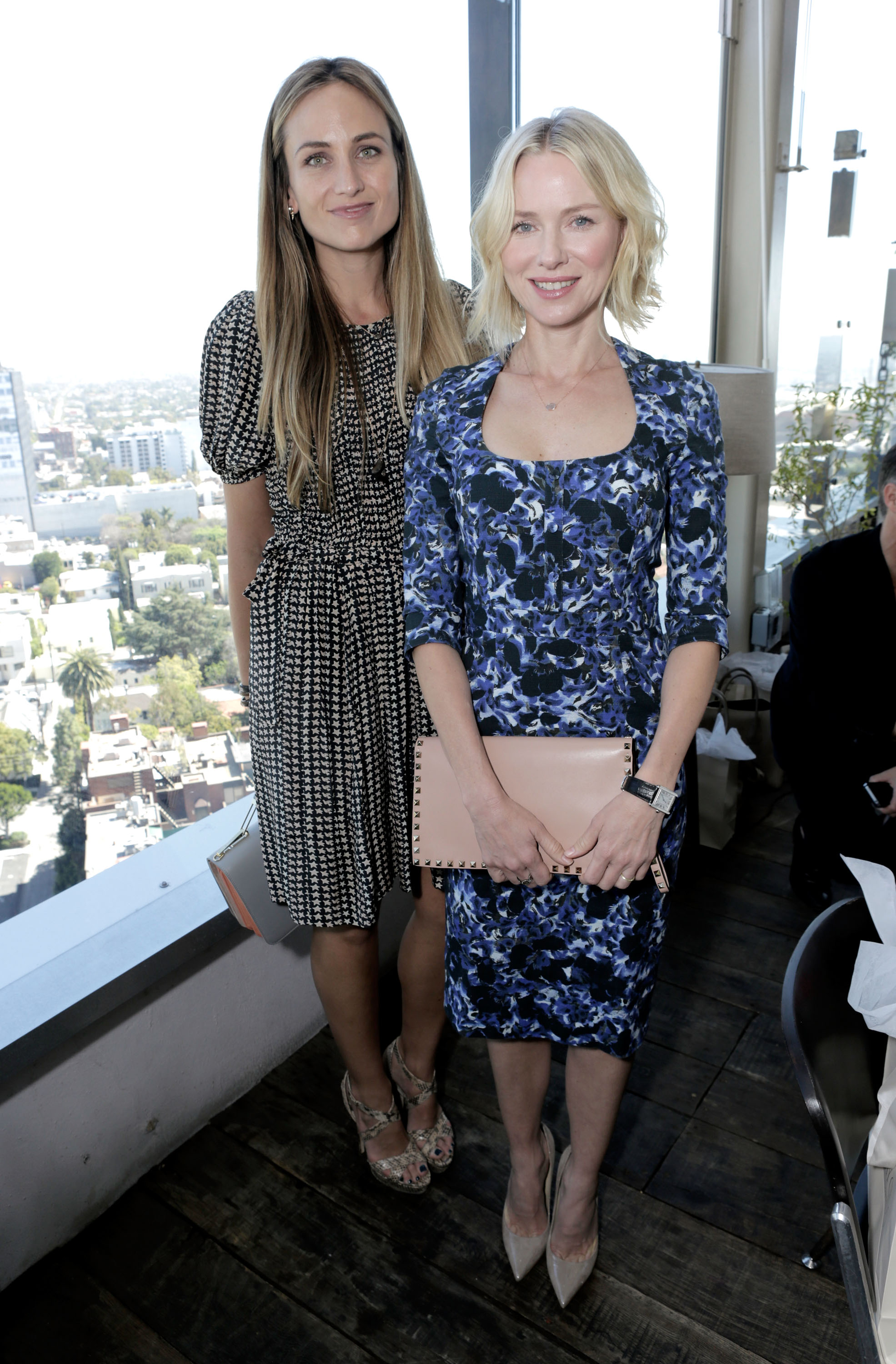 Naomi Watts picked a floral Erdem dress from the Resort 2013 collection, then completed her sweet look with nude Jimmy Choo shoes and a studded Valentino clutch while posing with stylist Jeanann Williams.
