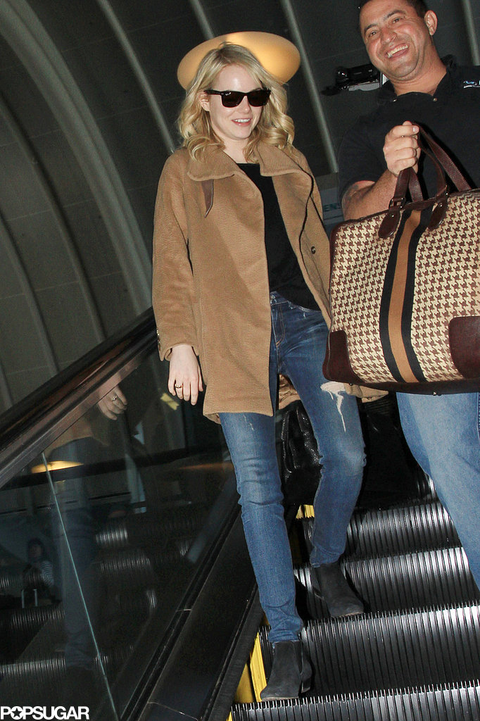 Emma Stone was all smiles as she traveled.