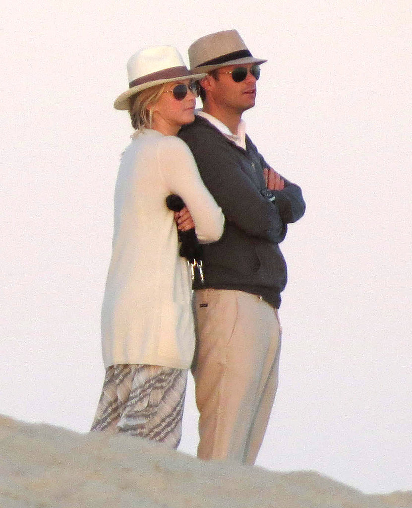 Julianne Hough cuddled up to Ryan Seacrest to watch a Cabo sunset in February 2012.