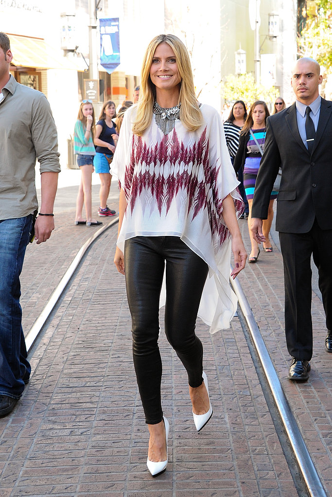 Heidi Klum strutted in an asymmetrical printed blouse, a silver statement necklace, black leather J Brand pants, then added on-trend white pointy pumps at The Grove in LA.