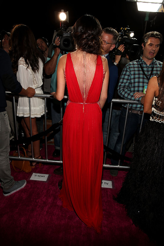 From the back, you'll see that Selena Gomez's Reem Acra gown also featured stunning beaded illusion paneling within the deep-V cut-out.