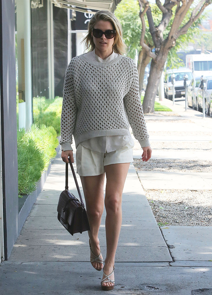 While taking a daytime stroll in LA, Ali Larter showed off a Springy way to work a monochromatic look in her Paper Denim & Cloth knit sweater and matching shorts.