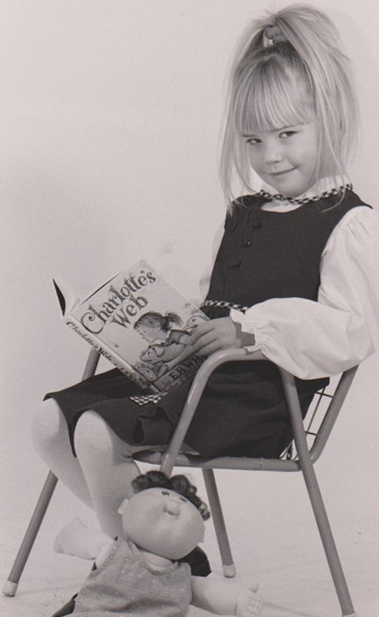 """Here's a headshot from when I was about 5 or 6, from my short-lived child-modeling career (let's be thankful that never took off). Once a bookworm, always a bookworm."" —  Nicole Perry, assistant editor, POPSUGAR Food"