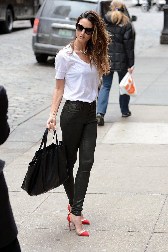 Lily Aldridge looked supersleek in black leather Citizens of Humanity jeans, a crisp white Lily Aldridge for Velvet tee, and red cap-toe pumps in NYC. She completed her tricolored ensemble with a black tote bag, cat-eye sunglasses, and a shiny rhinestone necklace.