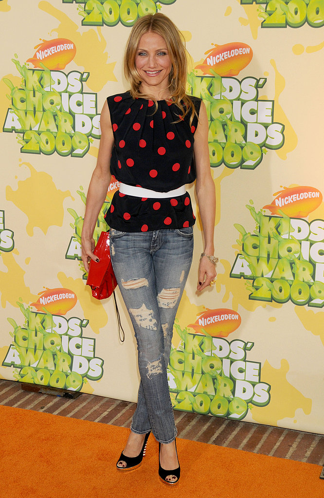 In 2009, Cameron Diaz belted a polka-dotted top, then opted for distressed skinny jeans and black peep-toe pumps.