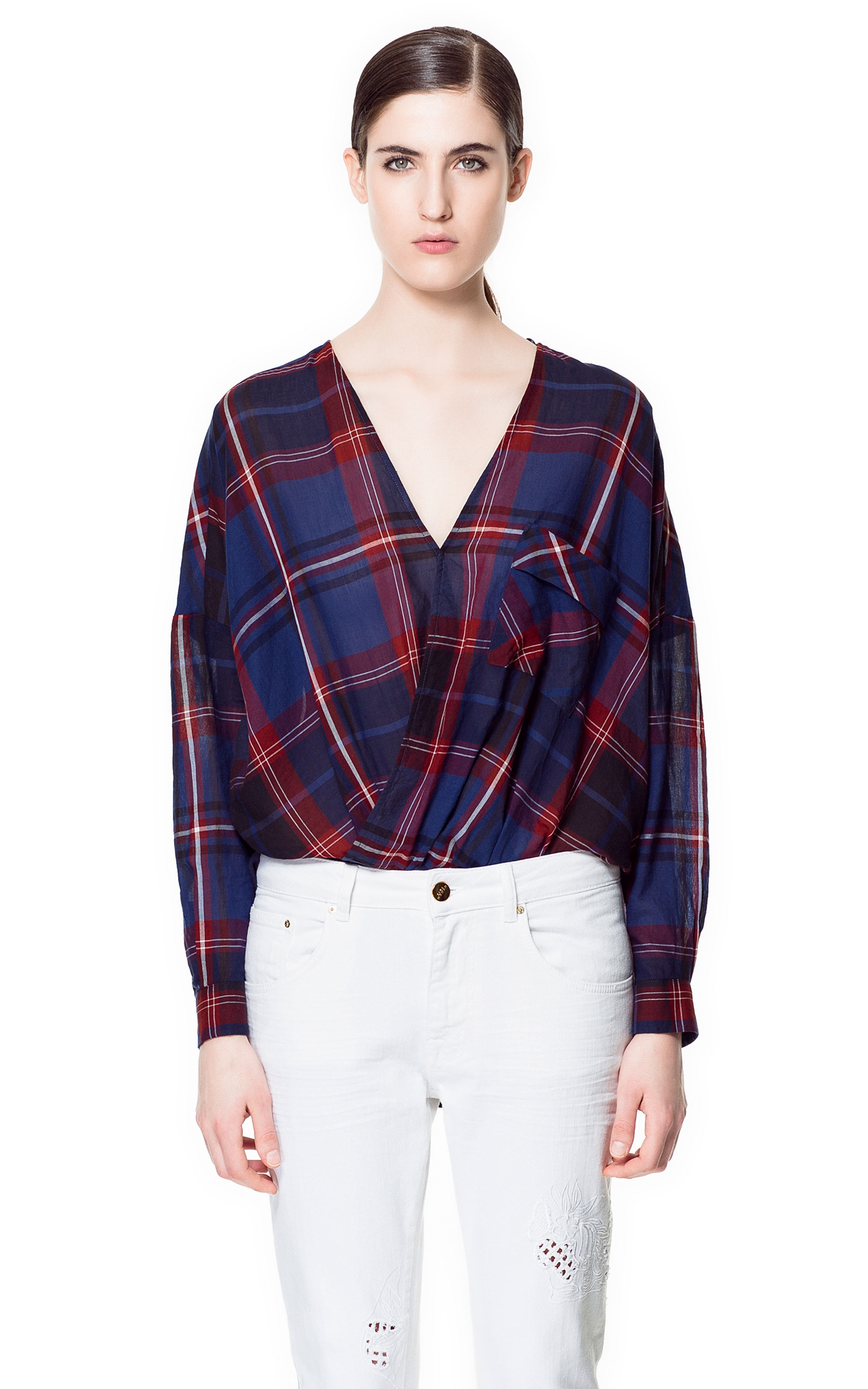 Zara's Crossover Blouse ($70) is a chic, easy way to get into the sheer plaid trend without breaking the bank. I'll be taking a cue from the Dries Van Noten Spring runway show and styling this top with a sequined pencil skirt and pointy-toe pumps. — Britt Stephens