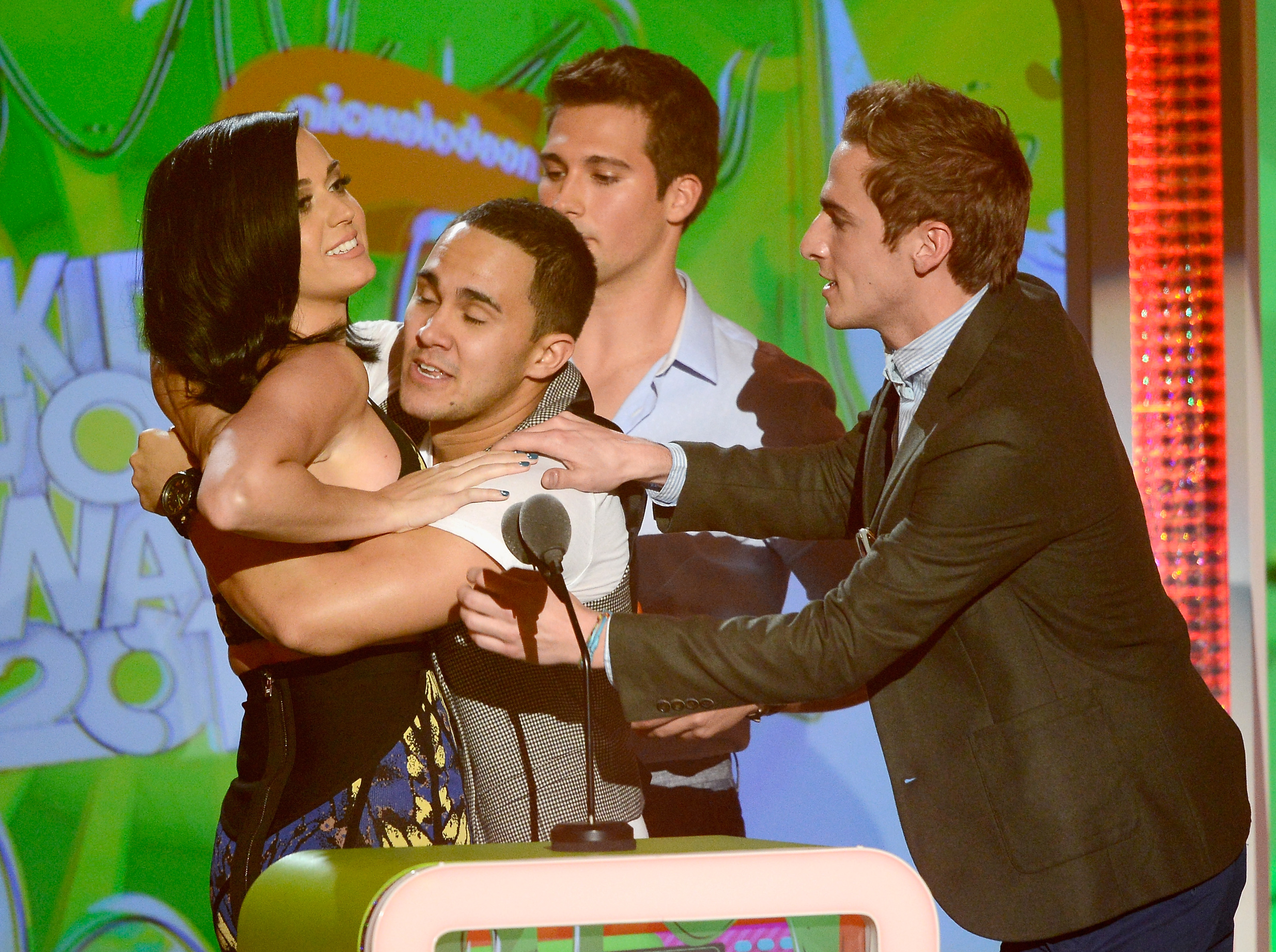 Katy Perry had to fend off the boys on stage at the Kids' Choice Awards.