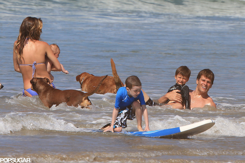 Gisele Bündchen and Tom Brady played in the water with Jack, Ben, and Vivian.