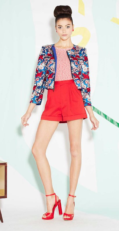 Here's a Spring style formula we can get behind: a boxy printed jacket with high-waisted shorts and matching sandals.