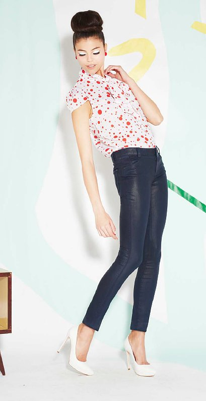 Here's a stylish way to bring your coated denim into Spring: via a printed blouse and white pumps.