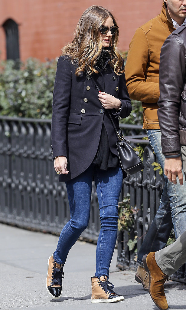 Olivia outfitted her skinny jeans and Lanvin high-tops with a military-style coat and a pair of standout Wunderkind sunglasses.