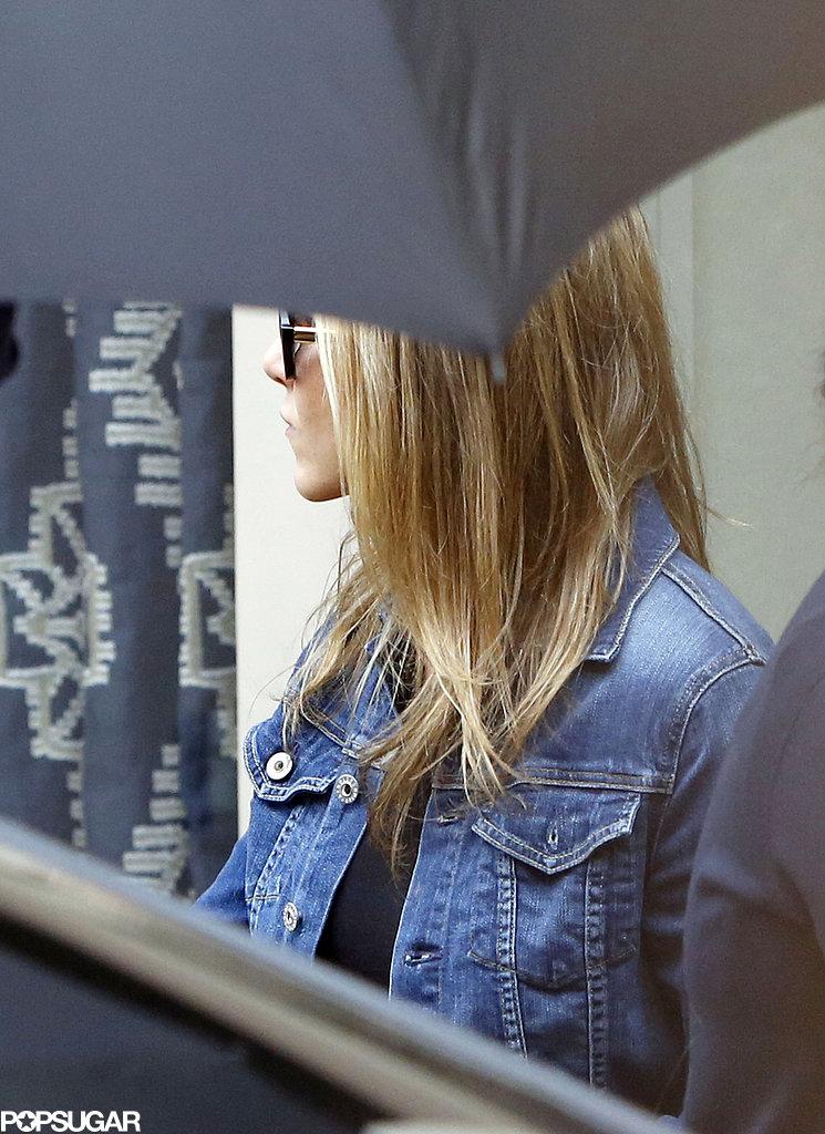 Jennifer Aniston wore a denim jacket.
