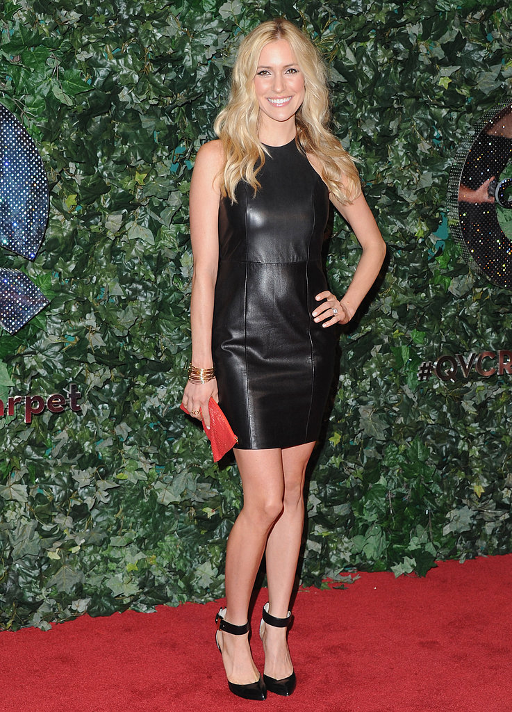 Kristin Cavallari hit the red carpet in a black leather racerback dress — we love how she kept accessories simple, opting for a pair of ankle-strap heels and a bright red clutch.