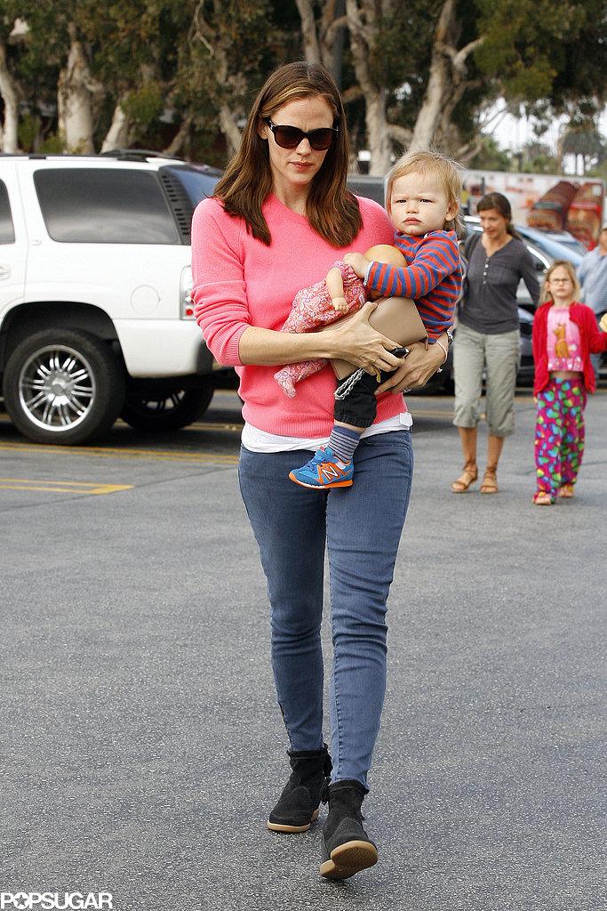 Jennifer Garner wore a pink sweater.