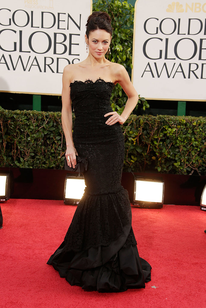 At the 2013 Golden Globe Awards, Olga Kurylenko showed off her svelte figure in a black strapless lace Dolce & Gabbana gown with a dramatic mermaid hemline.