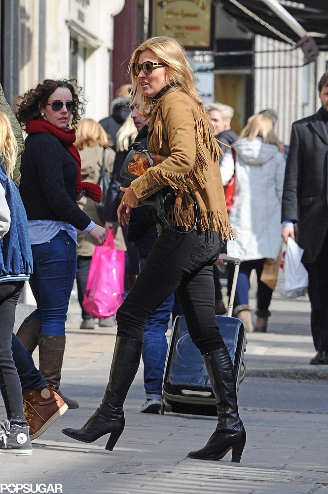 Kate Moss wore a fringed suede jacket in London.
