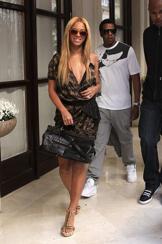While vacationing in France in April 2011, Beyoncé donned a printed dress and Jay-Z coordinated his white printed tee with his crisp white sneakers.