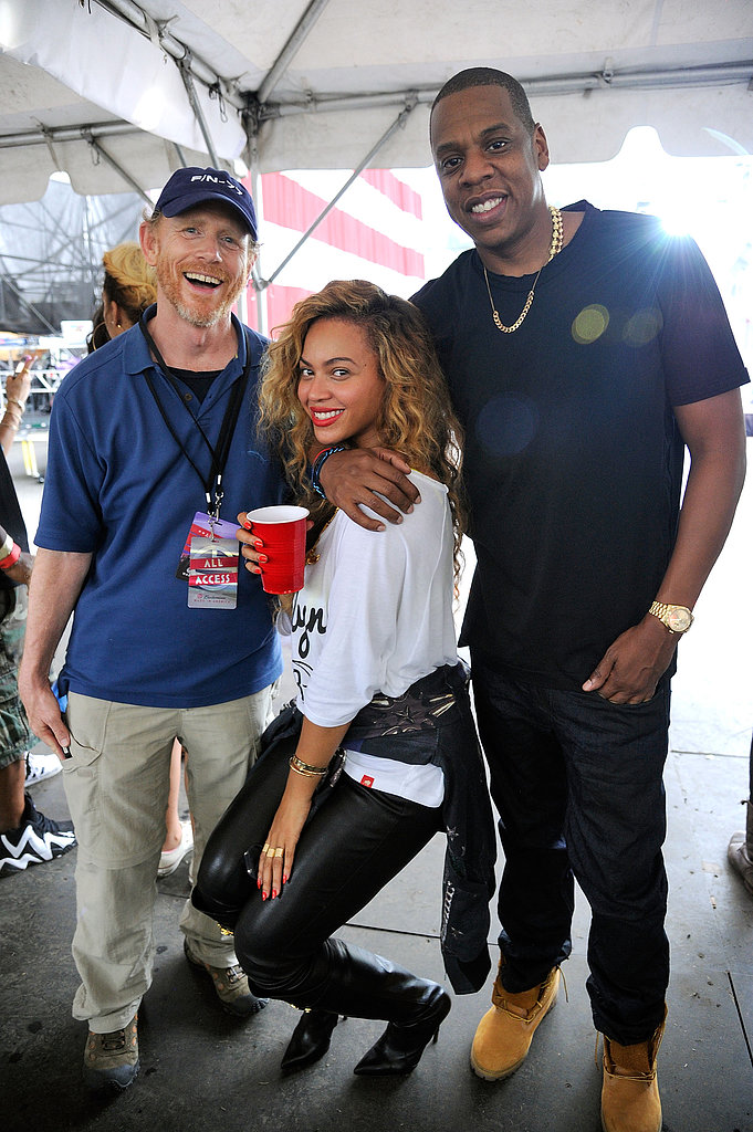 Jay-Z and Beyoncé stayed coordinated in gold accessories at the Made in America festival in September 2012.