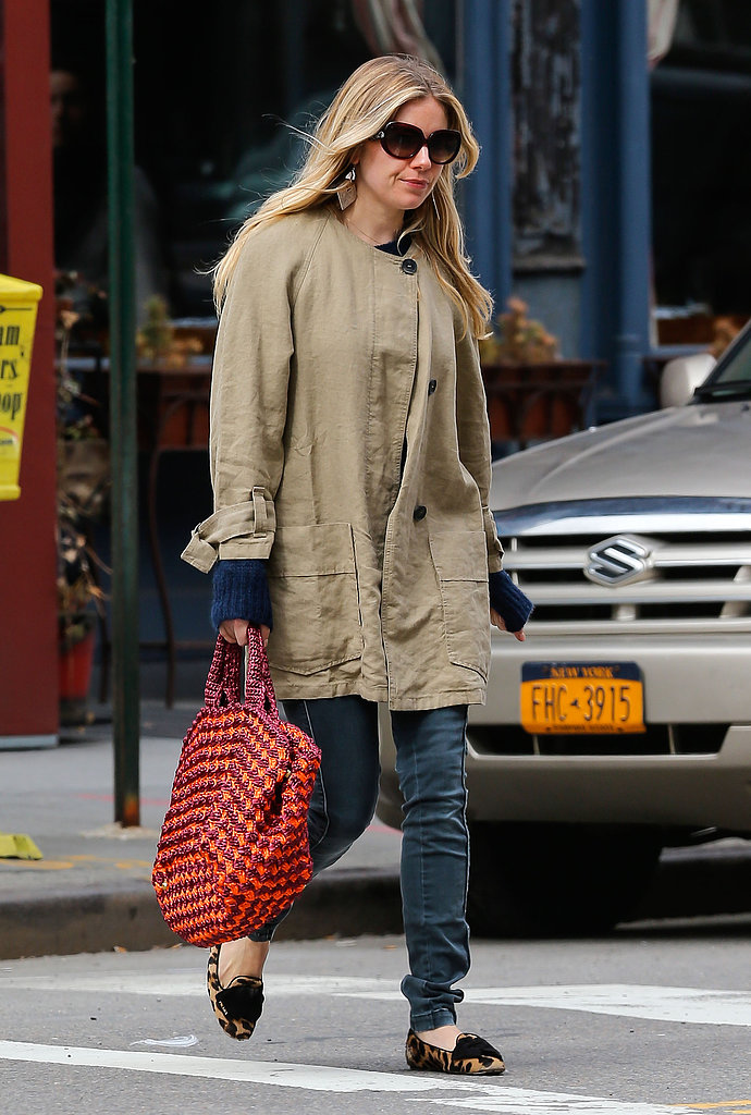 Sienna Miller paired her favorite leopard loafers with an olive-green coat, skinny jeans, and a colorful crochet bag during a day out in NYC.