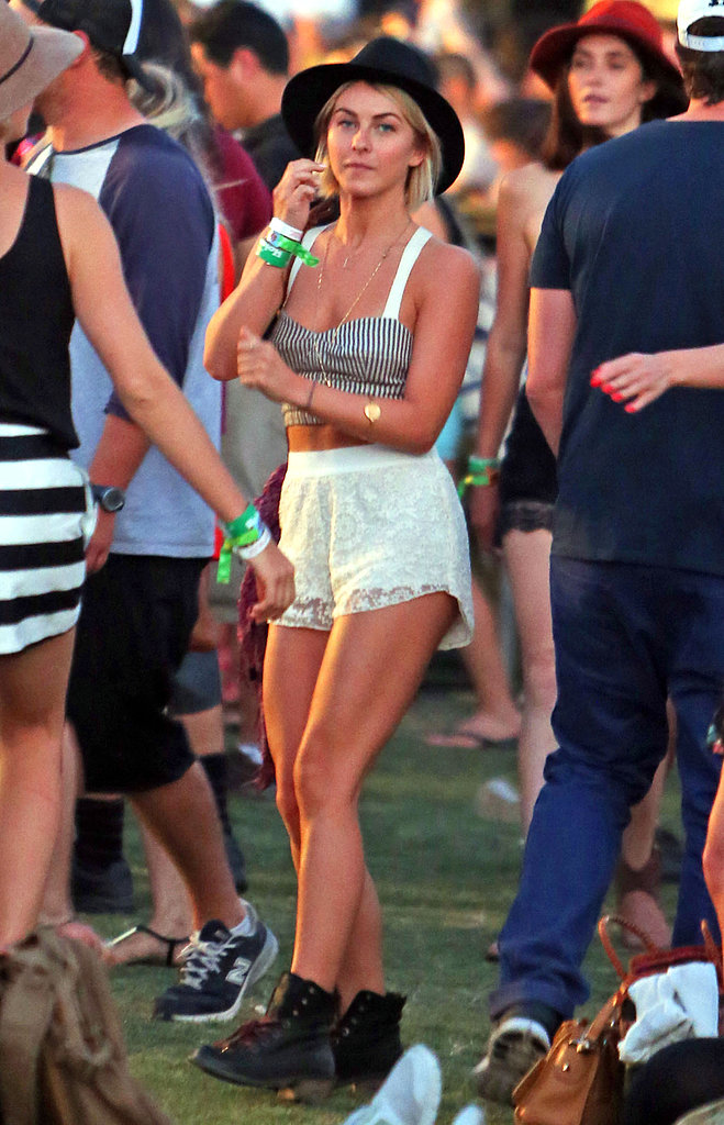 Julianne Hough's festival style included a striped crop top, ivory lace shorts, black lace-up boots, and a black hat.